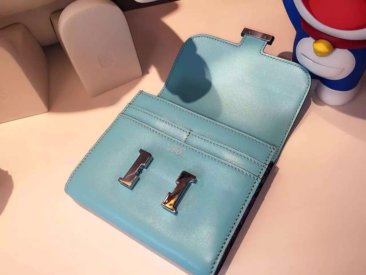 Hermes 3P Lagon Blue Swift Leather Silk'in Small Constance Wallet 14CM